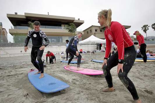 Surf Diva helps kids and corporate types -  like these guys - learn to surf.
